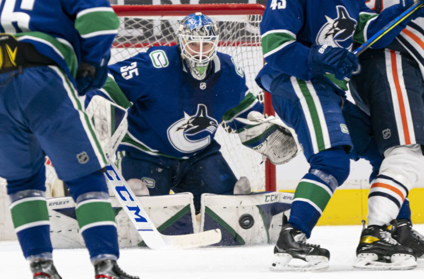 VANCOUVER, BC - MARCH 13: Goalie Thatcher Demko #35 of the Vancouver Canucks makes a save against the Edmonton Oilers during the second period of NHL action at Rogers Arena on March 13, 2021 in Vancouver, Canada. (Photo by Rich Lam/Getty Images)