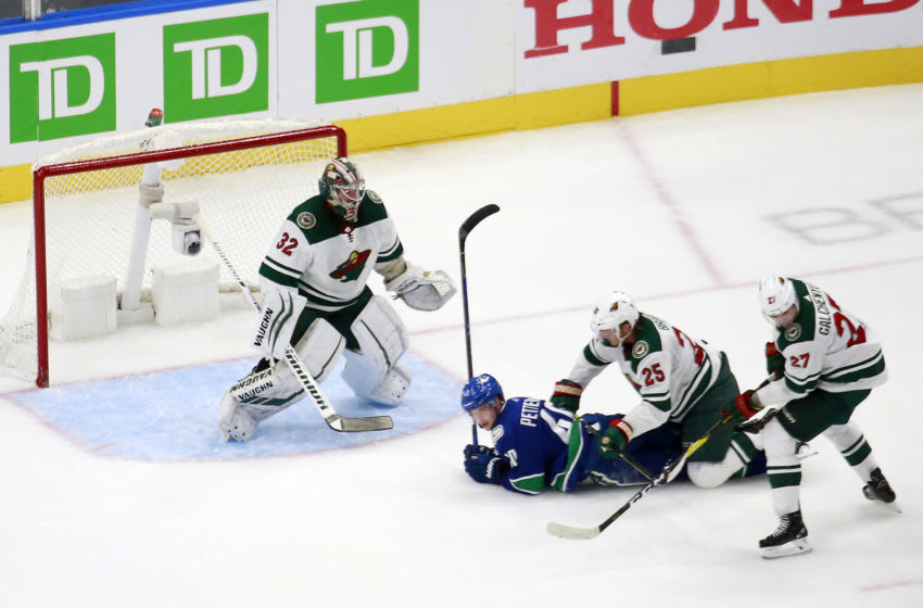 EDMONTON, ALBERTA - AUGUST 02: Elias Pettersson #40 of the Vancouver Canucks battles with Jonas Brodin #25 of the Minnesota Wild as Alex Stalock #32 of the Minnesota Wild defends the net in Game One of the Western Conference Qualification Round prior to the 2020 NHL Stanley Cup Playoffs at Rogers Place on August 02, 2020 in Edmonton, Alberta, Canada. (Photo by Jeff Vinnick/Getty Images)