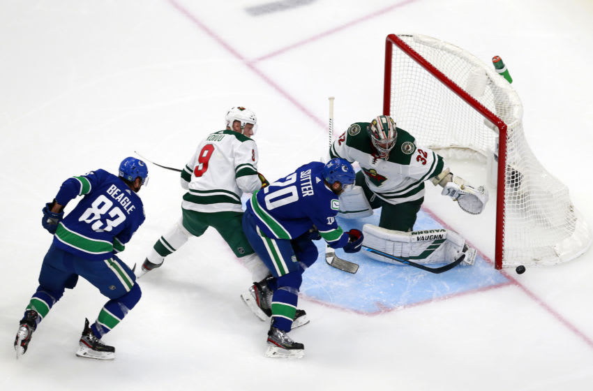 EDMONTON, ALBERTA - AUGUST 02: Alex Stalock #32 of the Minnesota Wild stops a shot from Brandon Sutter #20 of the Vancouver Canucks in Game One of the Western Conference Qualification Round prior to the 2020 NHL Stanley Cup Playoffs at Rogers Place on August 02, 2020 in Edmonton, Alberta, Canada. (Photo by Jeff Vinnick/Getty Images)