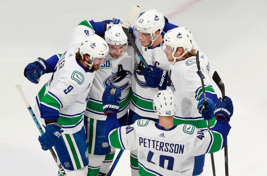 EDMONTON, ALBERTA - AUGUST 12: Bo Horvat #53 of the Vancouver Canucks (3rd from left) celebrates his power-play goal at 4:29 of the first period against the St. Louis Blues in Game One of the Western Conference First Round during the 2020 NHL Stanley Cup Playoffs at Rogers Place on August 12, 2020 in Edmonton, Alberta, Canada. (Photo by Jeff Vinnick/Getty Images)