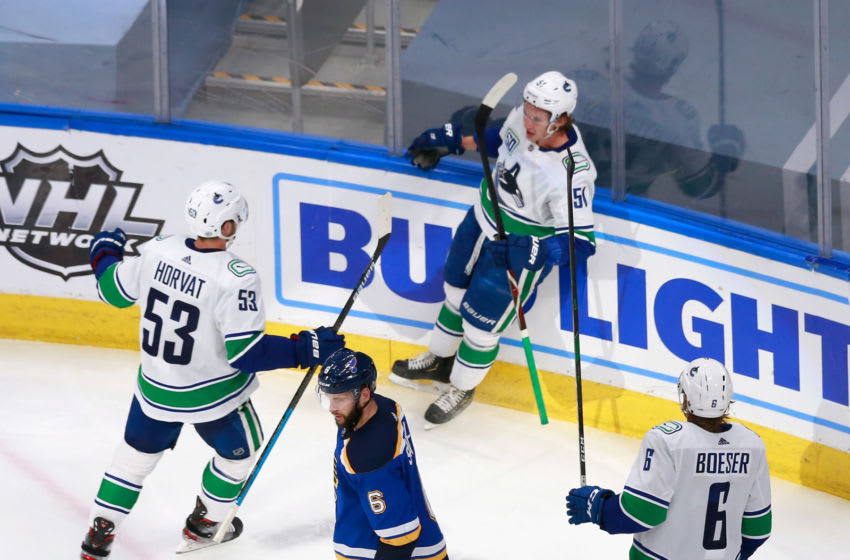 EDMONTON, ALBERTA - AUGUST 12: Troy Stecher #51 of the Vancouver Canucks (C) celebrates his goal at 5:36 of the third period against the St. Louis Blues in Game One of the Western Conference First Round during the 2020 NHL Stanley Cup Playoffs at Rogers Place on August 12, 2020 in Edmonton, Alberta, Canada. (Photo by Jeff Vinnick/Getty Images)