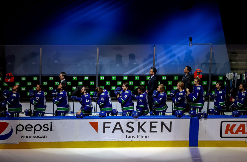 EDMONTON, ALBERTA - SEPTEMBER 03: The Vancouver Canucks stand for the national anthem prior to Game Six of the Western Conference Second Round against the Vegas Golden Knights during the 2020 NHL Stanley Cup Playoffs at Rogers Place on September 03, 2020 in Edmonton, Alberta, Canada. (Photo by Bruce Bennett/Getty Images)
