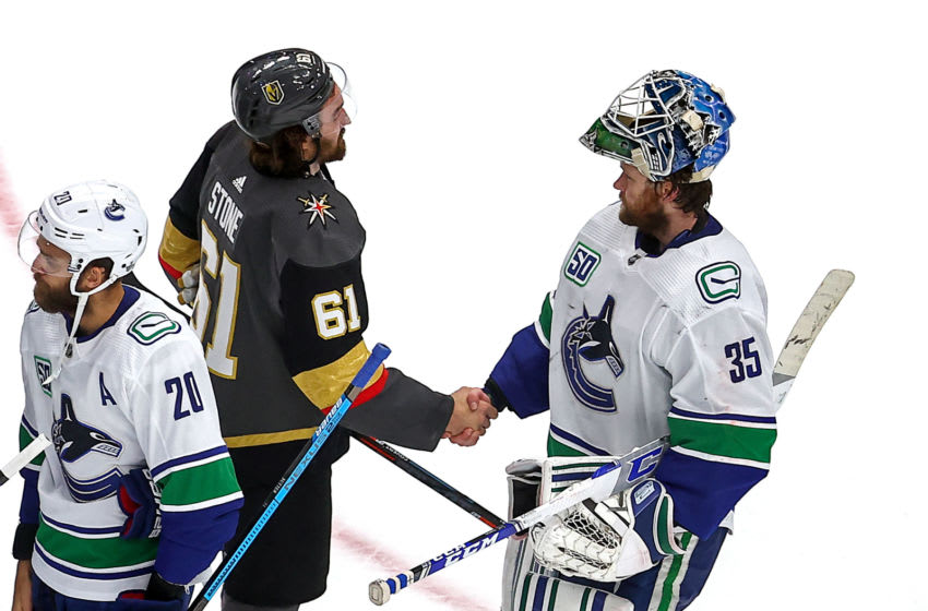 EDMONTON, ALBERTA - SEPTEMBER 04: Mark Stone #61 of the Vegas Golden Knights shakes hands with Thatcher Demko #35 of the Vancouver Canucks after the Golden Knights 3-0 victory in Game Seven of the Western Conference Second Round during the 2020 NHL Stanley Cup Playoffs at Rogers Place on September 04, 2020 in Edmonton, Alberta, Canada. (Photo by Bruce Bennett/Getty Images)