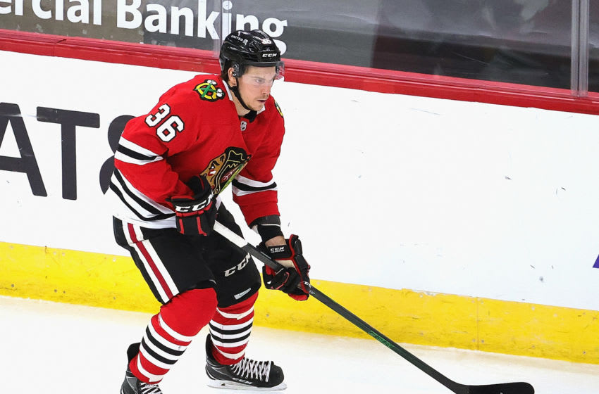 CHICAGO, ILLINOIS - FEBRUARY 02: Matthew Highmore #36 of the Chicago Blackhawks controls the puck against the Carolina Hurricanes at the United Center on February 02, 2021 in Chicago, Illinois. (Photo by Jonathan Daniel/Getty Images)