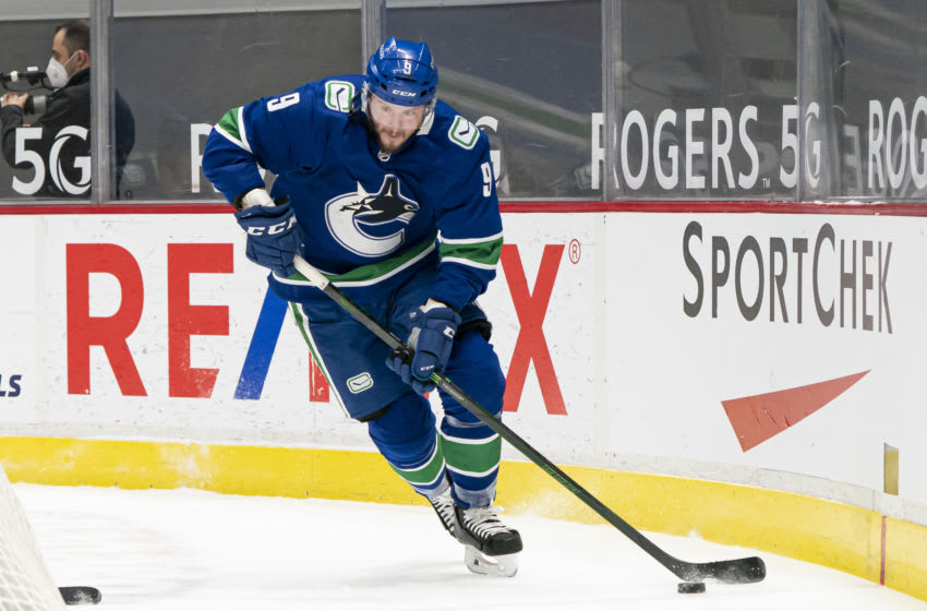 VANCOUVER, BC - MARCH 08: JT Miller #9 of the Vancouver Canucks skates with the puck during NHL hockey action against the Montreal Canadiens at Rogers Arena on March 8, 2021 in Vancouver, Canada. (Photo by Rich Lam/Getty Images)