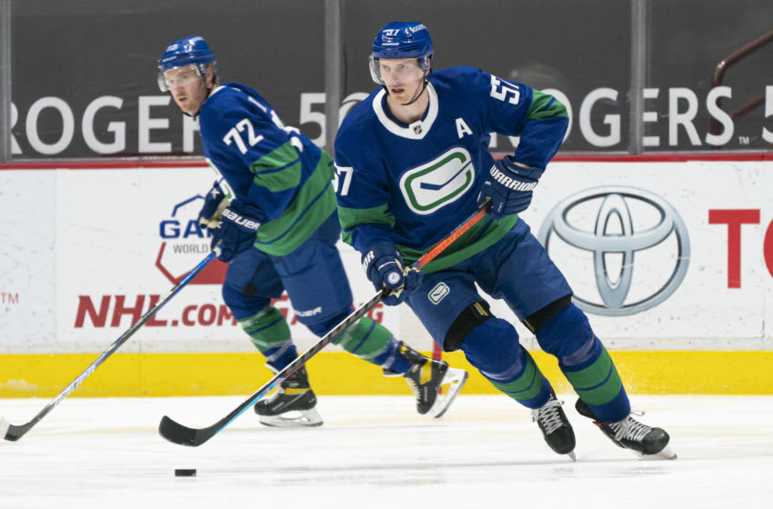 VANCOUVER, BC - APRIL 22: Tyler Myers #57 of the Vancouver Canucks skates with the puck during NHL action against the Ottawa Senators at Rogers Arena on April 22, 2021 in Vancouver, Canada. (Photo by Rich Lam/Getty Images)