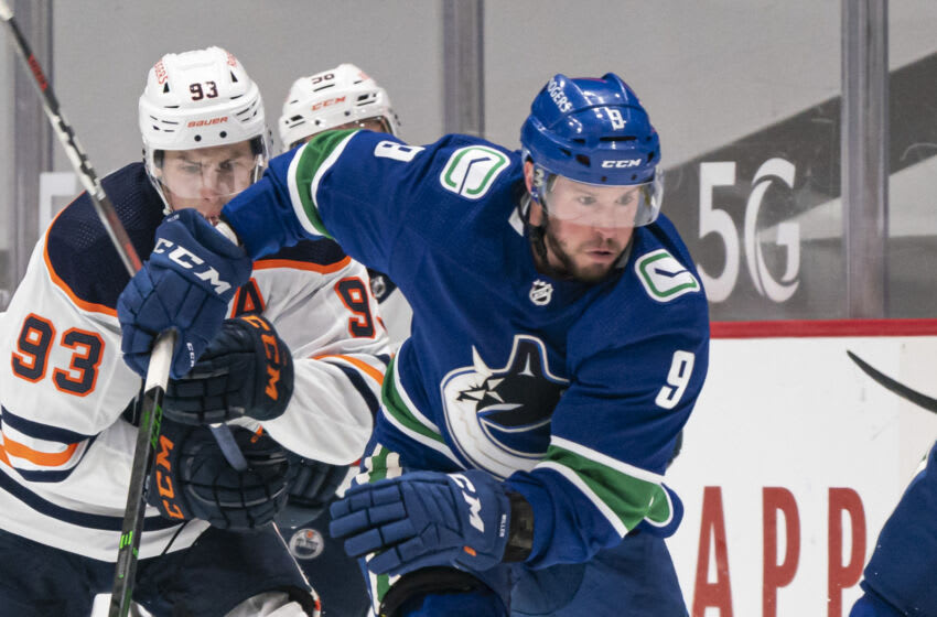 VANCOUVER, BC - MAY 03: J.T. Miller #9 of the Vancouver Canucks skates with the puck during NHL action against the Edmonton Oilers at Rogers Arena on April 16, 2021 in Vancouver, Canada. (Photo by Rich Lam/Getty Images)