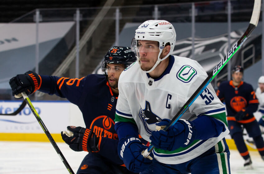 EDMONTON, AB - MAY 15: Bo Horvat #53 of the Vancouver Canucks battles against Darnell Nurse #25 of the Edmonton Oilers at Rogers Place on May 15, 2021 in Edmonton, Canada. (Photo by Codie McLachlan/Getty Images)