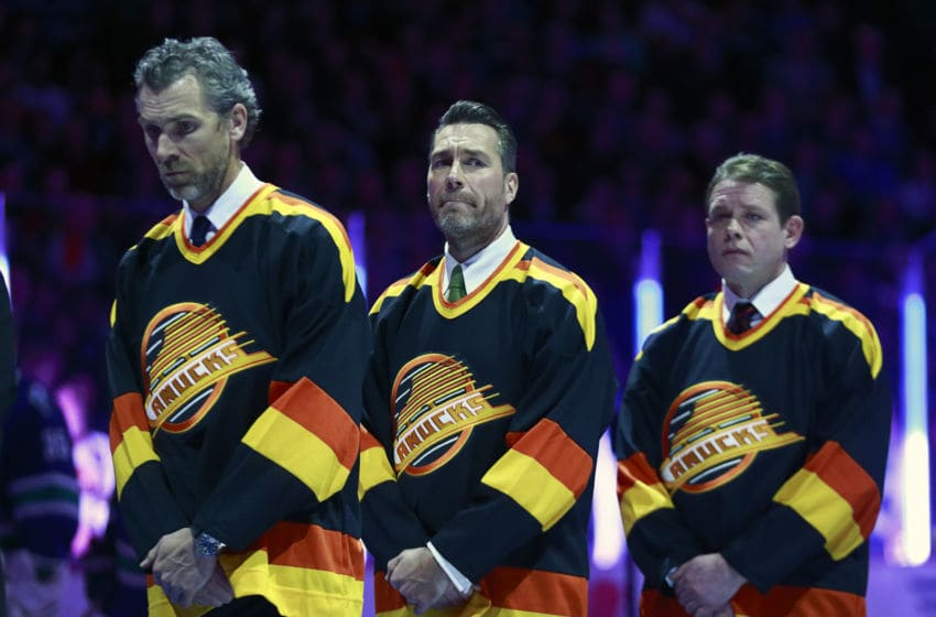 VANCOUVER, BC - MARCH 17: Former Vancouver Canucks (L-R) Trevor Linden, Kirk McLean and Pavel Bure listen to the national anthem during their NHL game against the Philadelphia Flyers at Rogers Arena March 17, 2015 in Vancouver, British Columbia, Canada. (Photo by Jeff Vinnick/NHLI via Getty Images)