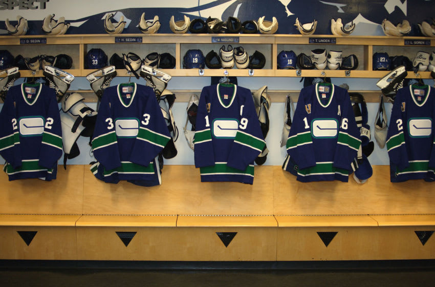 VANCOUVER - DECEMBER 4: Vancouver Canucks jerseys are hung in the locker room before the NHL game against the Boston Bruins at General Motors Place on December 4, 2005 in Vancouver, Canada. The Canucks defeated the Bruins 5-2. (Photo by Jeff Vinnick/Getty Images)