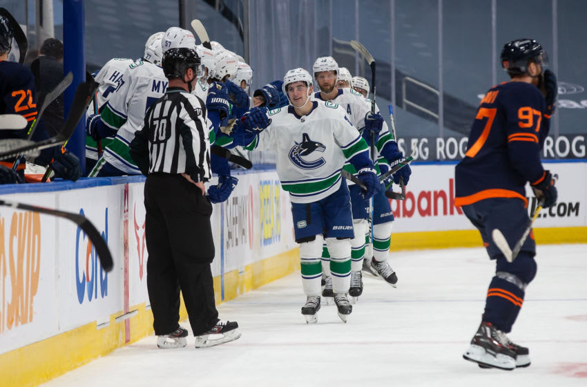 EDMONTON, AB - JANUARY 13: Nils Hoglander #36 of the Vancouver Canucks celebrates a goal against the Edmonton Oilers at Rogers Place on January 13, 2021 in Edmonton, Canada. (Photo by Codie McLachlan/Getty Images)