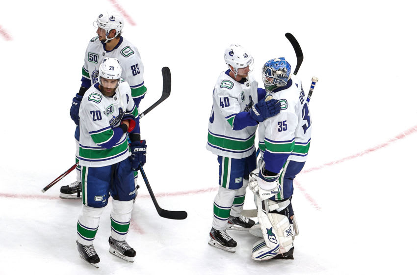 EDMONTON, ALBERTA - SEPTEMBER 04: Elias Pettersson #40 of the Vancouver Canucks consoles Thatcher Demko #35 after their teams 3-0 defeat against the Vegas Golden Knights during in Game Seven of the Western Conference Second Round during the 2020 NHL Stanley Cup Playoffs at Rogers Place on September 04, 2020 in Edmonton, Alberta, Canada. (Photo by Bruce Bennett/Getty Images)