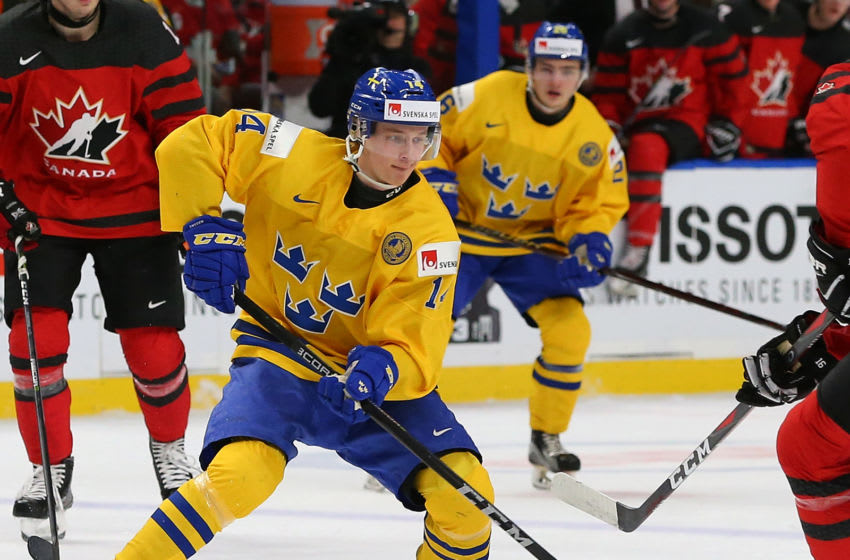 BUFFALO, NY - JANUARY 5: Elias Pettersson #14 of Sweden in play against Canada during the Gold medal game of the IIHF World Junior Championship at KeyBank Center on January 5, 2018 in Buffalo, New York. Canada beat Sweden 3-1. (Photo by Kevin Hoffman/Getty Images)