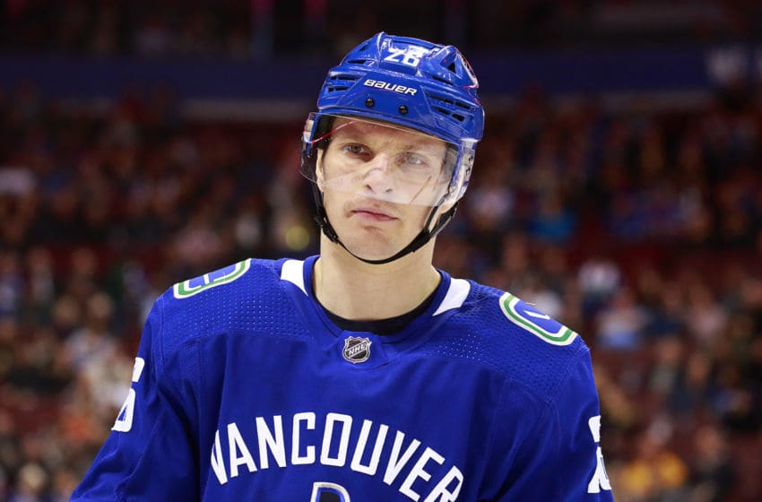 VANCOUVER, BC - MARCH 13: Antoine Roussel #26 of the Vancouver Canucks skates up ice during their NHL game against the New York Rangers at Rogers Arena March 13, 2019 in Vancouver, British Columbia, Canada. (Photo by Jeff Vinnick/NHLI via Getty Images)