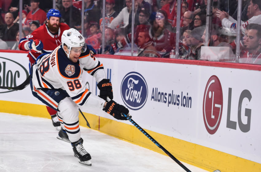 MONTREAL, QC - FEBRUARY 03: Jesse Puljujarvi #98 of the Edmonton Oilers skates the puck along the boards against the Montreal Canadiens during the NHL game at the Bell Centre on February 3, 2019 in Montreal, Quebec, Canada. The Montreal Canadiens defeated the Edmonton Oilers 4-3 in overtime. (Photo by Minas Panagiotakis/Getty Images)