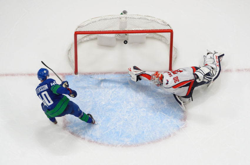 VANCOUVER, BC - OCTOBER 25: Elias Pettersson #40 of the Vancouver Canucks scores on Ilya Samsonov #30 of the Washington Capitals during their NHL game at Rogers Arena October 25, 2019 in Vancouver, British Columbia, Canada. (Photo by Derek Cain/NHLI via Getty Images)