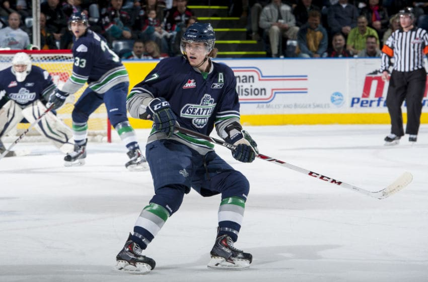 KELOWNA, CANADA - APRIL 3: Mitch Elliot #7 of the Seattle Thunderbirds skates against the Kelowna Rockets on April 3, 2014 during Game 1 of the second round of WHL Playoffs at Prospera Place in Kelowna, British Columbia, Canada. (Photo by Marissa Baecker/Getty Images)