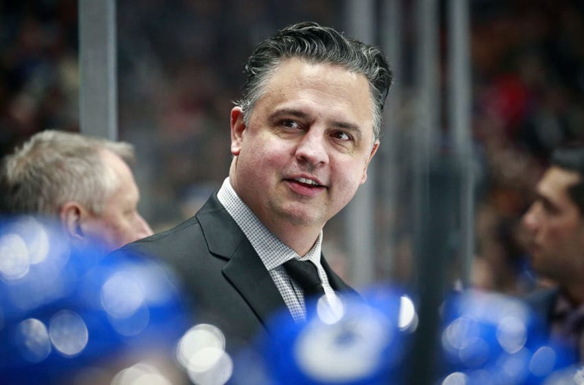 VANCOUVER, BC - DECEMBER 12: Head coach Travis Green of the Vancouver Canucks smiles as he looks on from the bench during their NHL game against the Carolina Hurricanes at Rogers Arena December 12, 2019 in Vancouver, British Columbia, Canada. Vancouver won 1-0. (Photo by Jeff Vinnick/NHLI via Getty Images)