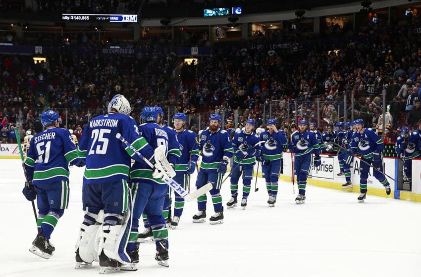 Jacob Markstrom #25 of the Vancouver Canucks is congratulated by teammates after their win against the Pittsburgh Penguins at Rogers Arena December 21, 2019 in Vancouver, British Columbia, Canada. Vancouver won 4-1. (Photo by Jeff Vinnick/NHLI via Getty Images)