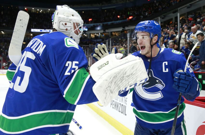 VANCOUVER, BC - DECEMBER 23: Bo Horvat #53 of the Vancouver Canucks congratulates teammate Jacob Markstrom #25 after winning their NHL game against the Edmonton Oilers at Rogers Arena December 23, 2019 in Vancouver, British Columbia, Canada. Vancouver won 4-2. (Photo by Jeff Vinnick/NHLI via Getty Images)