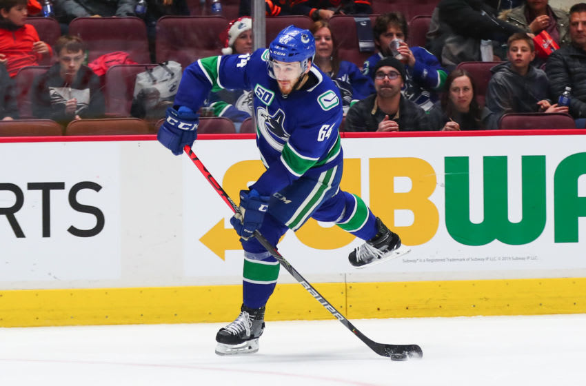 VANCOUVER, BC - DECEMBER 23: Vancouver Canucks Right Wing Tyler Motte (64) takes a shot against the Edmonton Oilers during their NHL game at Rogers Arena on December 23, 2019 in Vancouver, British Columbia, Canada. (Photo by Devin Manky/Icon Sportswire via Getty Images)