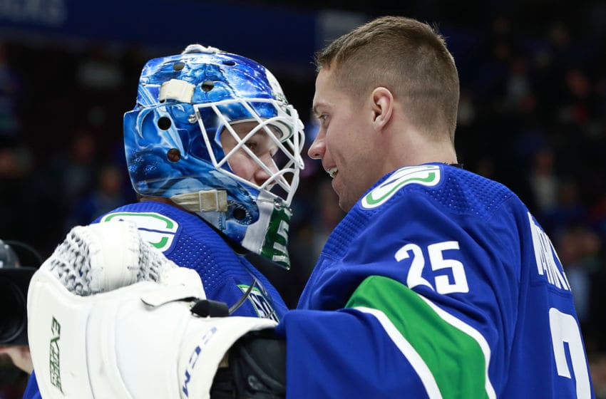 VANCOUVER, BC - OCTOBER 28: Thatcher Demko #35 of the Vancouver Canucks is congratulated by teammate Jacob Markstrom #25 after winning their NHL game against the Florida Panthers at Rogers Arena October 28, 2019 in Vancouver, British Columbia, Canada. Vancouver won 7-2. (Photo by Jeff Vinnick/NHLI via Getty Images)