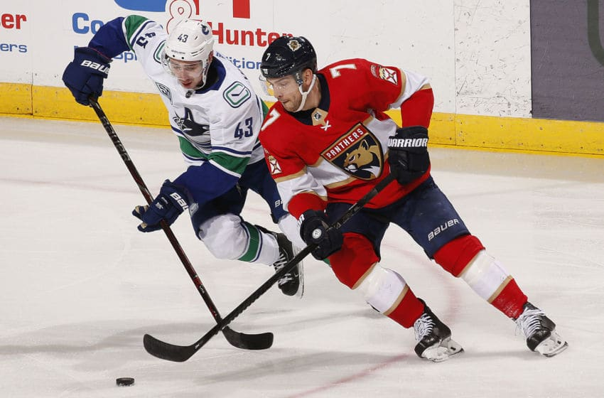 SUNRISE, FL - JANUARY 09: Colton Sceviour #7 of the Florida Panthers crosses sticks with Quinn Hughes #43 of the Vancouver Canucks at the BB&T Center on January 9, 2020 in Sunrise, Florida. (Photo by Eliot J. Schechter/NHLI via Getty Images)