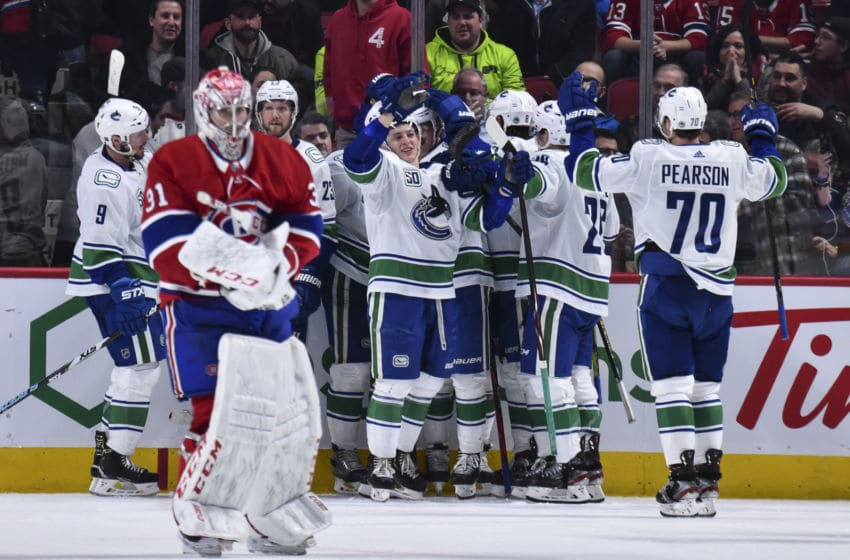 MONTREAL, QC - FEBRUARY 25: The Vancouver Canucks celebrate their victory against the Montreal Canadiens during overtime at the Bell Centre on February 25, 2020 in Montreal, Canada. The Vancouver Canucks defeated the Montreal Canadiens 4-3 in overtime. (Photo by Minas Panagiotakis/Getty Images)