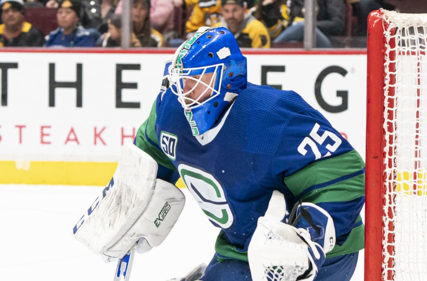 VANCOUVER, BC - FEBRUARY 22: Goalie Jacob Markstrom #25 of the Vancouver Canucks readies to make a save during NHL action against the Boston Bruins at Rogers Arena on February 22, 2020 in Vancouver, Canada. (Photo by Rich Lam/Getty Images)