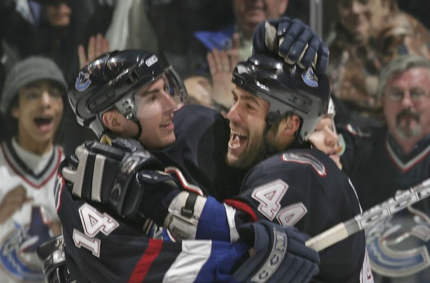 VANCOUVER - MARCH 27: Alexandre Burrows #14 of the Vancouver Canucks is congratulated by teammate Todd Bertuzzi #44 after scoring on the Los Angeles Kings at General Motors Place on March 27, 2006 in Vancouver, Canada. Vancouver defeated Los Angeles 7-4. (Photo by Jeff Vinnick/Getty Images)