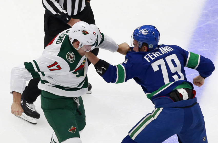 EDMONTON, ALBERTA - AUGUST 02: Marcus Foligno #17 of the Minnesota Wild fights with Micheal Ferland #79 of the Vancouver Canucks in Game One of the Western Conference Qualification Round prior to the 2020 NHL Stanley Cup Playoffs at Rogers Place on August 02, 2020 in Edmonton, Alberta, Canada. (Photo by Jeff Vinnick/Getty Images)