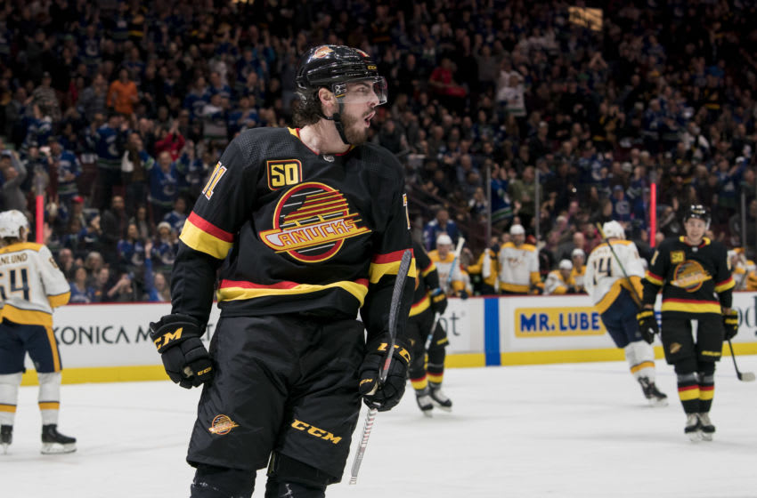 Feb 10, 2020; Vancouver, British Columbia, CAN; Vancouver Canucks forward Zack MacEwen (71) celebrates his first period goal against the Nashville Predatorsduring the first period in a game at Rogers Arena. Mandatory Credit: Bob Frid-USA TODAY Sports