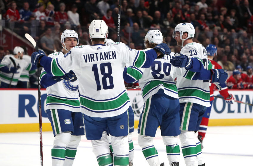 Feb 25, 2020; Montreal, Quebec, CAN; Vancouver Canucks defenseman Alexander Edler (23) celebrates his goal against Montreal Canadiens with teammates during the second period at Bell Centre. Mandatory Credit: Jean-Yves Ahern-USA TODAY Sports