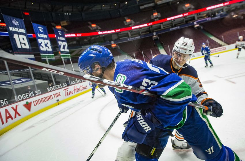 May 3, 2021; Vancouver, British Columbia, CAN; Edmonton Oilers forward Alex Chiasson (39) checks Vancouver Canucks defenseman Alexander Edler (23) in the third period at Rogers Arena. Oilers won 5-3. Mandatory Credit: Bob Frid-USA TODAY Sports