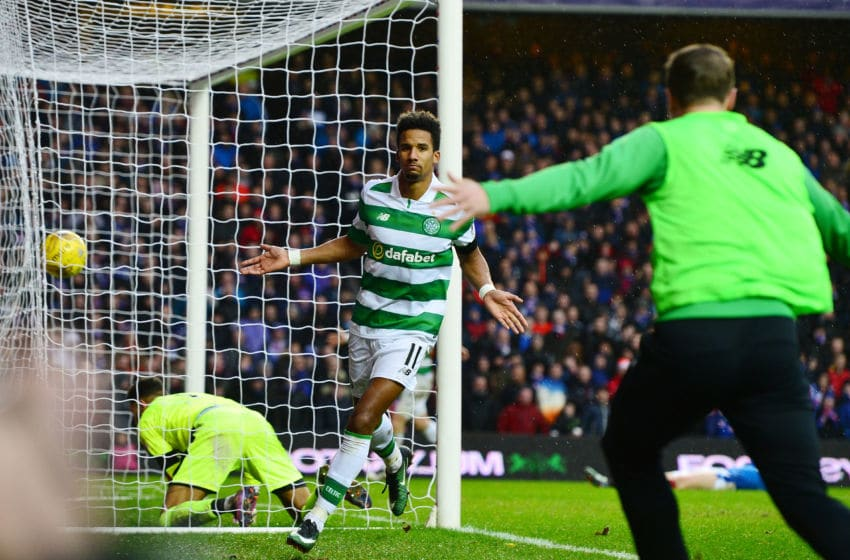 GLASGOW, SCOTLAND - DECEMBER 31: Scott Sinclair (L) of Celtic celebrates scoring his team's second goal with his team mate Leigh Griffiths (R) during the Ladbrokes Scottish Premiership match between Rangers and Celtic at Ibrox Stadium on December 31, 2016 in Glasgow, Scotland. (Photo by Mark Runnacles/Getty Images)