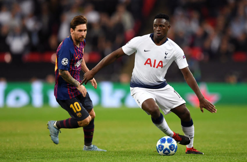 LONDON, ENGLAND - OCTOBER 03: Victor Wanyama of Tottenham Hotspur is challanged by Lionel Messi of Barcelona during the Group B match of the UEFA Champions League between Tottenham Hotspur and FC Barcelona at Wembley Stadium on October 3, 2018 in London, United Kingdom. (Photo by Shaun Botterill/Getty Images)