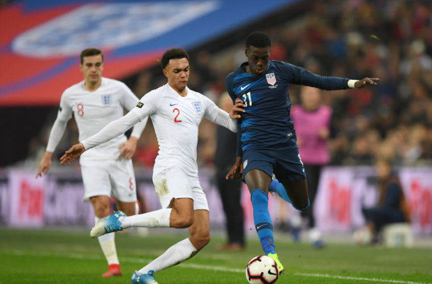 LONDON, ENGLAND - NOVEMBER 15: Timothy Weah of the United States is challenged by Trent Alexander-Arnold of England during the International Friendly match between England and United States at Wembley Stadium on November 15, 2018 in London, United Kingdom. (Photo by Shaun Botterill/Getty Images)