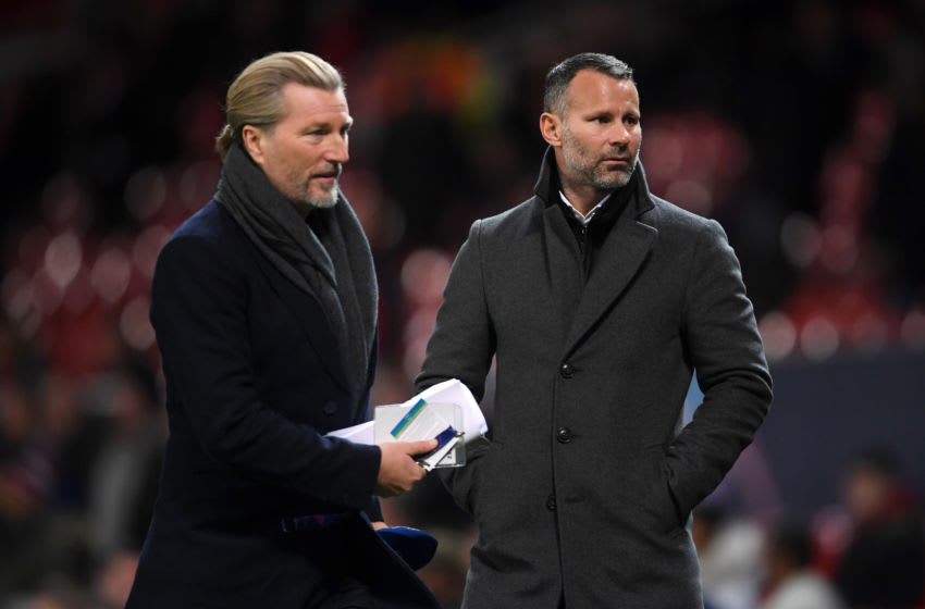 MANCHESTER, ENGLAND - NOVEMBER 27: Robbie Savage and Ryan Giggs look on prior to the UEFA Champions League Group H match between Manchester United and BSC Young Boys at Old Trafford on November 27, 2018 in Manchester, United Kingdom. (Photo by Laurence Griffiths/Getty Images)