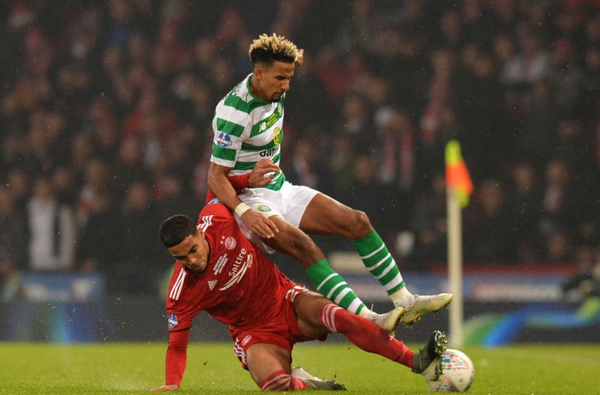 GLASGOW, SCOTLAND - DECEMBER 02: Scott Sinclair of Celtic is challenged by Max Lowe of Aberdeen during the Betfred Cup Final between Celtic and Aberdeen at Hampden Park on December 2, 2018 in Glasgow, Scotland. (Photo by Mark Runnacles/Getty Images)