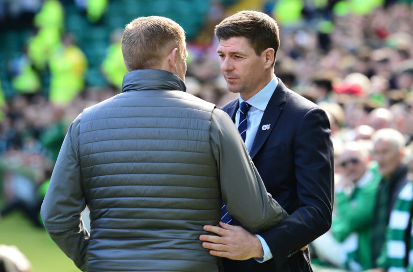 GLASGOW, SCOTLAND - MARCH 31: Neil Lennon, Interim manager of Celtic embraces Steven Gerrard, Manager of Rangers ahead of the Ladbrokes Scottish Premiership match between Celtic and Rangers at Celtic Park on March 31, 2019 in Glasgow, Scotland. (Photo by Mark Runnacles/Getty Images)