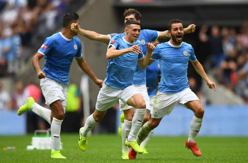 LONDON, ENGLAND - AUGUST 04: Bernardo Silva, Phil Foden and John Stones of Manchester City celebrate following their team's victory in the penalty shoot out during the FA Community Shield match between Liverpool and Manchester City at Wembley Stadium on August 04, 2019 in London, England. (Photo by Clive Mason/Getty Images)