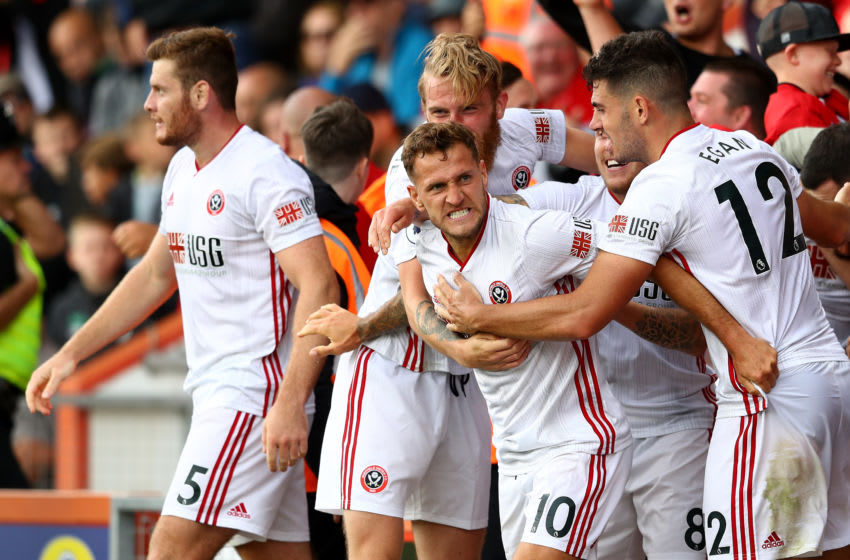 BOURNEMOUTH, ENGLAND - AUGUST 10: Billy Sharp of Sheffield United celebrates with teammates after scoring his team's first goal during the Premier League match between AFC Bournemouth and Sheffield United at Vitality Stadium on August 10, 2019 in Bournemouth, United Kingdom. (Photo by Michael Steele/Getty Images)