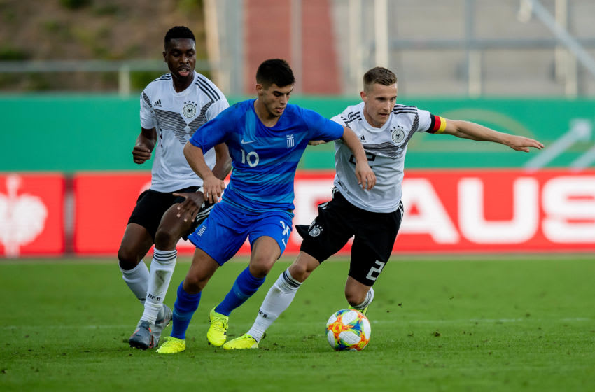 ZWICKAU, GERMANY - SEPTEMBER 05: Johannes Eggestein (R) of Germany is challenged by Ioannis Bouzoukis of Greece during the U21 international friendly match between Germany and Greece at GGZ ARENA on September 05, 2019 in Zwickau, Germany. (Photo by Thomas Eisenhuth/Getty Images for DFB)