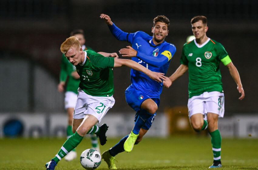TALLAGHT, IRELAND - OCTOBER 10: Liam Scales of Republic of Ireland in action against Manuel Locatelli of Italy during the UEFA U21 Championships Qualifier match between the Republic of Ireland and Italy at Tallaght Stadium on October 10, 2019 in Tallaght, Ireland. (Photo by Harry Murphy/Getty Images)