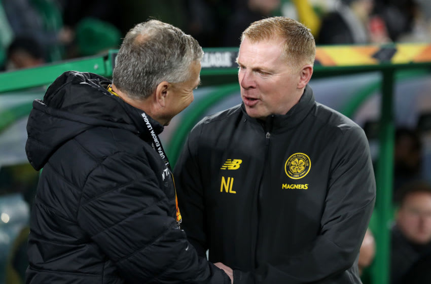 GLASGOW, SCOTLAND - OCTOBER 03: Neil Lennon, Manager of Celtic shakes hands with Dan Petrescu, Head coach of CFR Cluj prior to the UEFA Europa League group E match between Celtic FC and CFR Cluj at Celtic Park on October 03, 2019 in Glasgow, United Kingdom. (Photo by Ian MacNicol/Getty Images)
