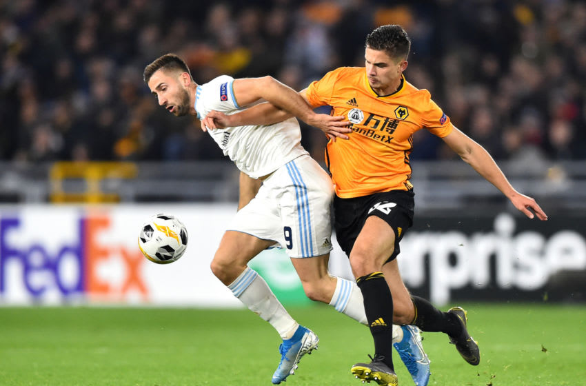 WOLVERHAMPTON, ENGLAND - NOVEMBER 07: Andraz Sporar of Slovan Bratislava and Leander Dendoncker of Wolverhampton Wanderers during the UEFA Europa League group K match between Wolverhampton Wanderers and Slovan Bratislava at Molineux on November 07, 2019 in Wolverhampton, United Kingdom. (Photo by Nathan Stirk/Getty Images)