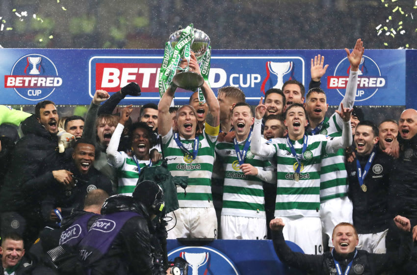 GLASGOW, SCOTLAND - DECEMBER 08: Scott Brown (C) of Celtic lifts the Betfred Cup with his teammates following victory in the Betfred Cup Final between Rangers FC and Celtic FC at Hampden Park on December 08, 2019 in Glasgow, Scotland. (Photo by Ian MacNicol/Getty Images)
