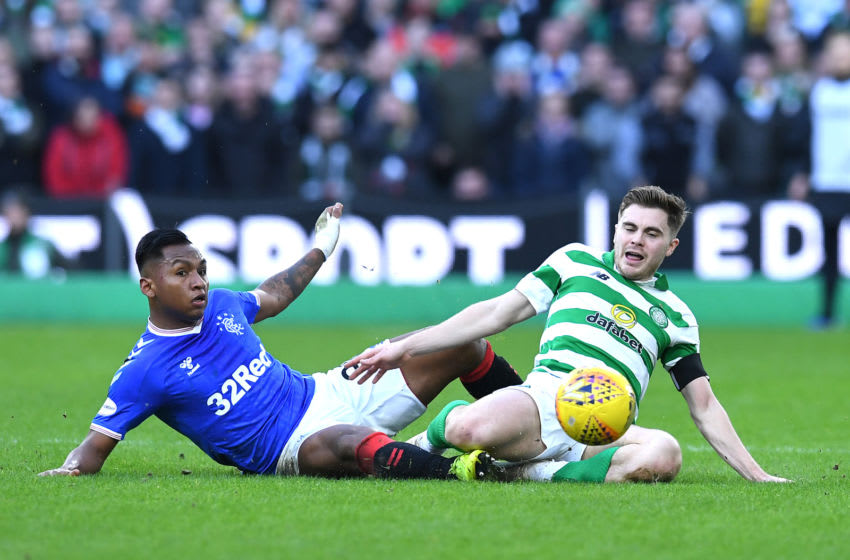 GLASGOW, SCOTLAND - DECEMBER 29: Alfredo Morelos of Rangers and James Forrest of Celtic battle for possession during the Ladbrokes Premiership match between Celtic and Rangers at Celtic Park on December 29, 2019 in Glasgow, Scotland. (Photo by Mark Runnacles/Getty Images)