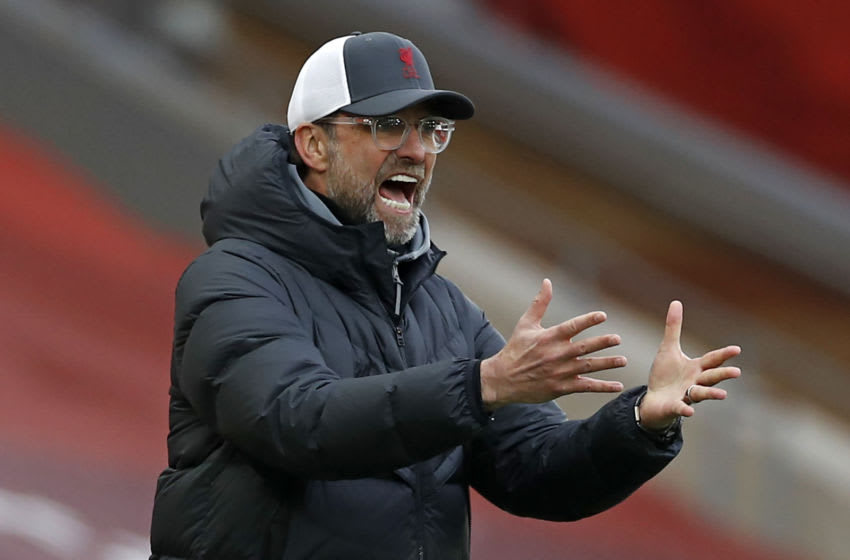 Liverpool's German manager Jurgen Klopp gestures on the touchline during the English Premier League football match between Liverpool and Fulham at Anfield in Liverpool, north west England on March 7, 2021. (Photo by PHIL NOBLE / POOL / AFP) / RESTRICTED TO EDITORIAL USE. No use with unauthorized audio, video, data, fixture lists, club/league logos or 'live' services. Online in-match use limited to 120 images. An additional 40 images may be used in extra time. No video emulation. Social media in-match use limited to 120 images. An additional 40 images may be used in extra time. No use in betting publications, games or single club/league/player publications. / (Photo by PHIL NOBLE/POOL/AFP via Getty Images)