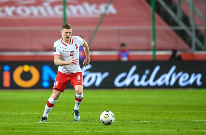 WARSAW, POLAND - MARCH 28: Kacper Kozlowski of Poland in action during the FIFA World Cup 2022 Qatar qualifying match between Poland and Andorra on March 28, 2021 in Warsaw, Poland. (Photo by Rafal Oleksiewicz/PressFocus/MB Media/Getty Images)